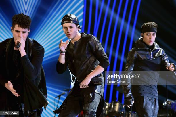 Zabdiel De Jesus Christopher Velez and Joel Pimentel of CNCO perform onstage during The 18th Annual Latin Grammy Awards at MGM Grand Garden Arena on...