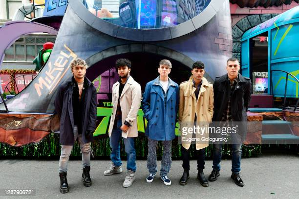 Zabdiel De Jesus, Erick Brian Colon, Christopher Velez, Joel Pimentel and Richard Camacho of CNCO pose in front of Teenage Mutant Ninja Turtles float...