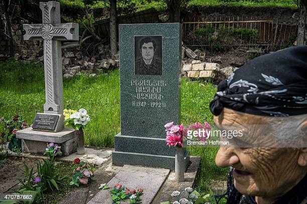 Zabela Bejanyan at the grave of her son Raynis Bejanyan, who was killed in the war between Armenia and Azerbaijan over Nagorno-Karabakh, on April 20,...