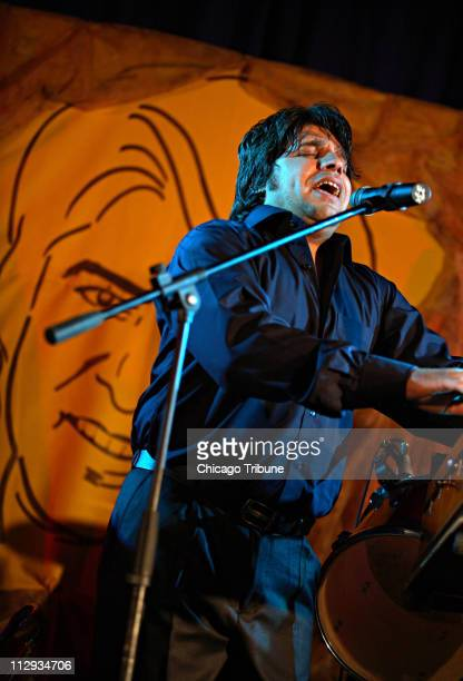 Zabihullah Jawanmard an Ahmed Zahir impersonator performs for a crowd of Afghans in Kabul June 14 2006 Zahir known as 'the Afghan Elvis' was the most...