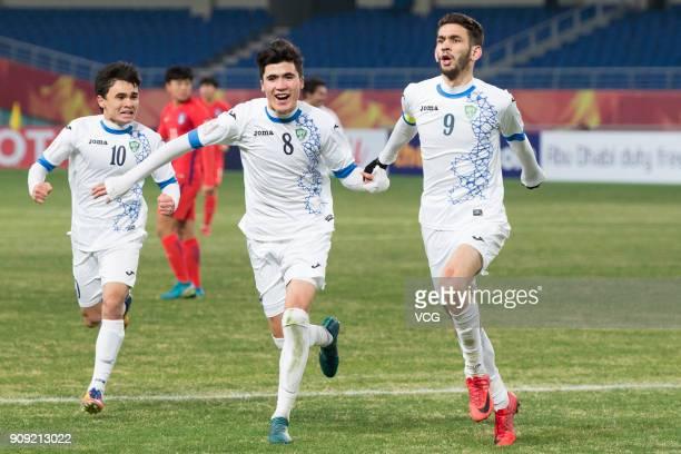 Zabikhillo Urinboev of Uzbekistan celebrates with team mates after scoring a goal during the AFC U23 Championship semifinal match between Uzbekistan...