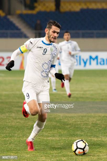Zabikhillo Urinboev of Uzbekistan drives the ball during the AFC U23 Championship semifinal match between Uzbekistan and South Korea at Kunshan...