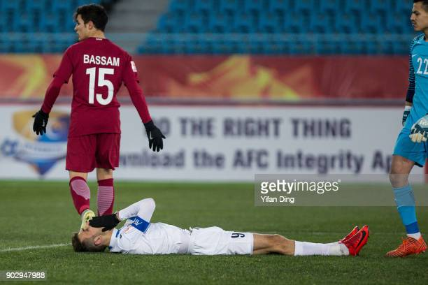 Zabikhillo Urinboev of Uzbekistan looks dejected after missing a scoring chance during the AFC U23 Championship Group A match between Qatar and...
