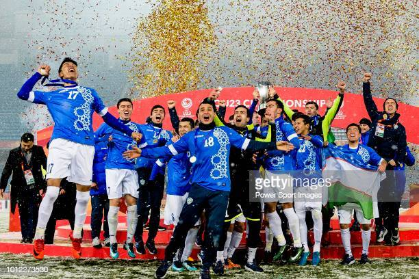 Zabikhillo Urinboev of Uzbekistan rise up the champion's trophy with his teammates during the AFC U23 Championship China 2018 match between Vietnam...