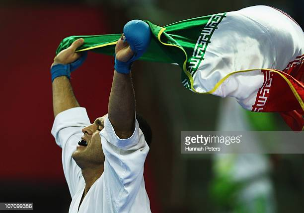 Zabiollah Poorshab of Iran celebrates winning the Men's 84kg final against Umar Syarief of Indonesia at Guangdong Gymnasium during day twelve of the...