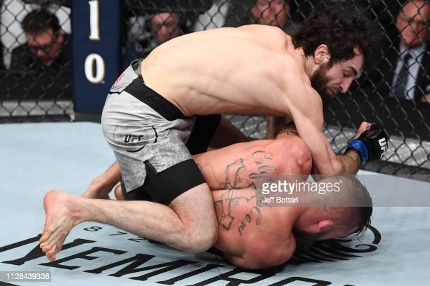 Zabit Magomedsharipov of Russia elbows Jeremy Stephens in their featherweight bout during the UFC 235 event at TMobile Arena on March 2 2019 in Las...