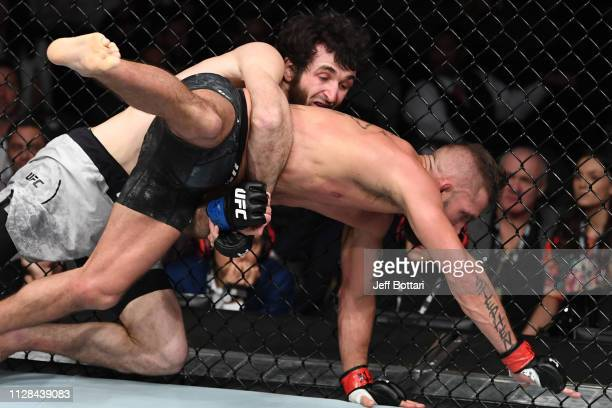 Zabit Magomedsharipov of Russia takes down Jeremy Stephens in their featherweight bout during the UFC 235 event at TMobile Arena on March 2 2019 in...