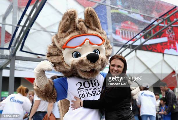 Zabivaka The Russian World Cup mascot poses for a photo with a fan outside the stadium prior to the FIFA Confederations Cup Russia 2017 PlayOff for...