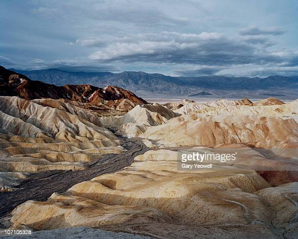 zabriskie point desert landscape at sunrise - yeowell stock photos and pictures