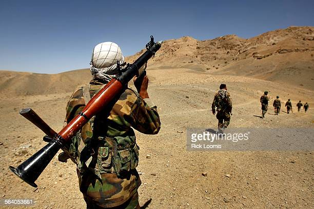 Zabul province Afghanistan – Afghan National Army soldiers engage in a foot patrol in the mountainous area of Zabul province as they seek to engage...