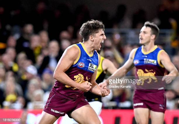 Zac Bailey of the Lions celebrates after kicking a goal during the round 10 AFL match between the Brisbane Lions and the Richmond Tigers at The Gabba...