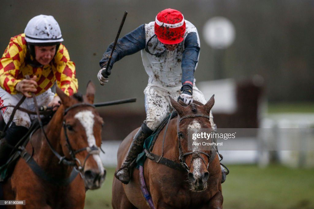 Zac Baker riding Tambura (R) clear the last to win The Starsports Daily Specials Mares' Handicap Hurdle Race at Towcester racecourse on February 14, 2018 in Towcester, England.