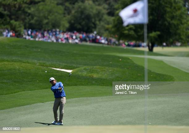Zac Blair plays an approach shot on the third hole during the final round of the Wells Fargo Championship at Eagle Point Golf Club on May 7 2017 in...