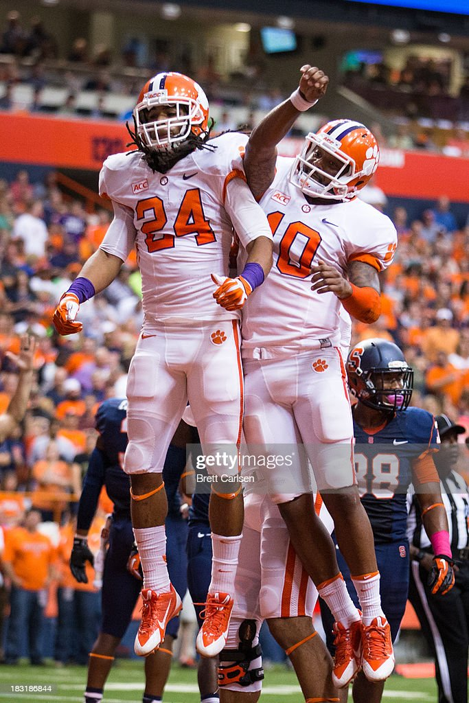 Zac Brooks #24 and Tajh Boyd #10 of Clemson Tigers jump to celebrate the team's second touchdown scored by Zac Brooks on a handoff in the first quarter against Syracuse Orange on October 5, 2013 at the Carrier Dome in Syracuse, New York. Clemson defeated Syracuse 49-14.