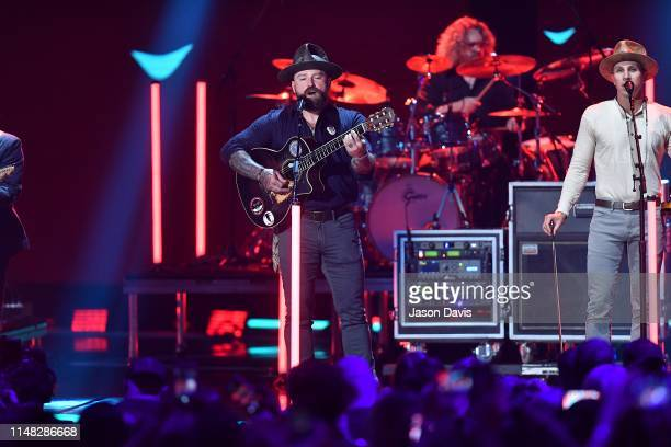 Zac Brown Band performs on stage during the 2019 CMT Music Awards Show at Bridgestone Arena on June 5 2019 in Nashville Tennessee