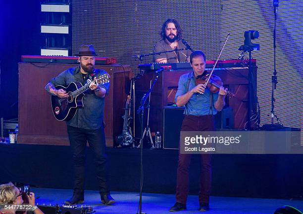 Zac Brown Clay Cook and Coy Bowles of the Zac Brown band perform during the Black Out The Sun Tour at DTE Energy Music Theater on July 2 2016 in...
