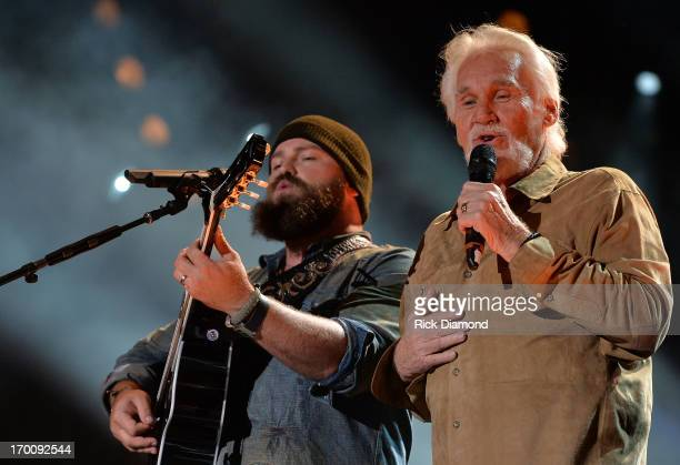 Zac Brown is joined on stage by Kenny Rogers to perform The Gambler during the 2013 CMA Music Festival on June 6 2013 in Nashville Tennessee