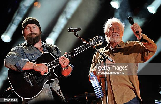 Zac Brown performs with Kenny Rogers at LP Field during the 2013 CMA Music Festival on June 6, 2013 in Nashville, Tennessee.