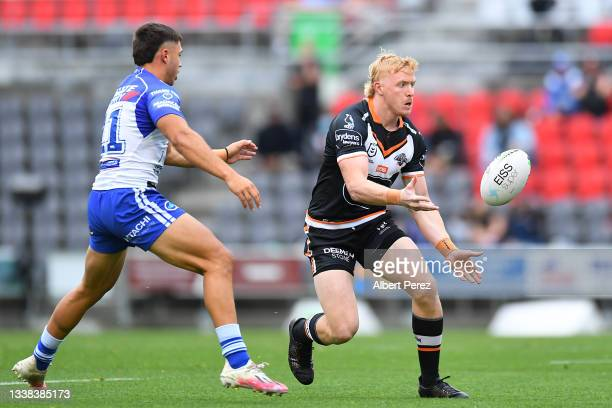 Zac Cini of the Tigers passes the ball during the round 25 NRL match between the Wests Tigers and the Canterbury Bulldogs at Moreton Daily Stadium,...