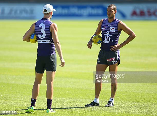 Zac Clarke and Michael Johnson talk as players warm up during a Fremantle Dockers AFL training session at Fremantle Oval on February 24 2014 in...