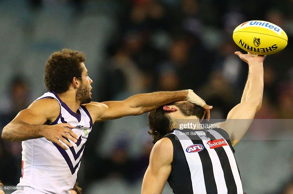 Zac Clarke of the Dockers and Brodie Grundy of the Magpies compete for the ball during the round 14 AFL match between the Collingwood Magpies and the Fremantle Dockers at Melbourne Cricket Ground on June 24, 2016 in Melbourne, Australia.