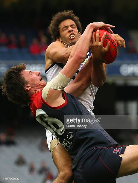 Zac Clarke of the Dockers marks over the top of Jack Fitzpatrick of the Demons during the round 21 AFL match between the Melbourne Demons and the...