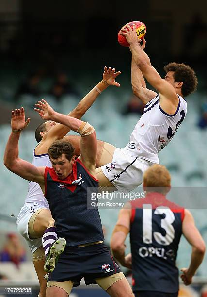 Zac Clarke of the Dockers marks over the top of Jake Spencer of the Demons during the round 21 AFL match between the Melbourne Demons and the...