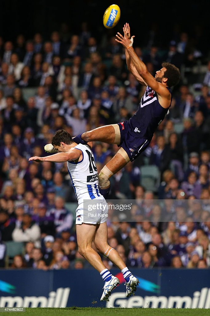 Zac Clarke of the Dockers sets for a mark against Scott Thompson of the Kangaroos during the round eight AFL match between the Fremantle Dockers and the North Melbourne Kangaroos at Domain Stadium on May 23, 2015 in Perth, Australia.