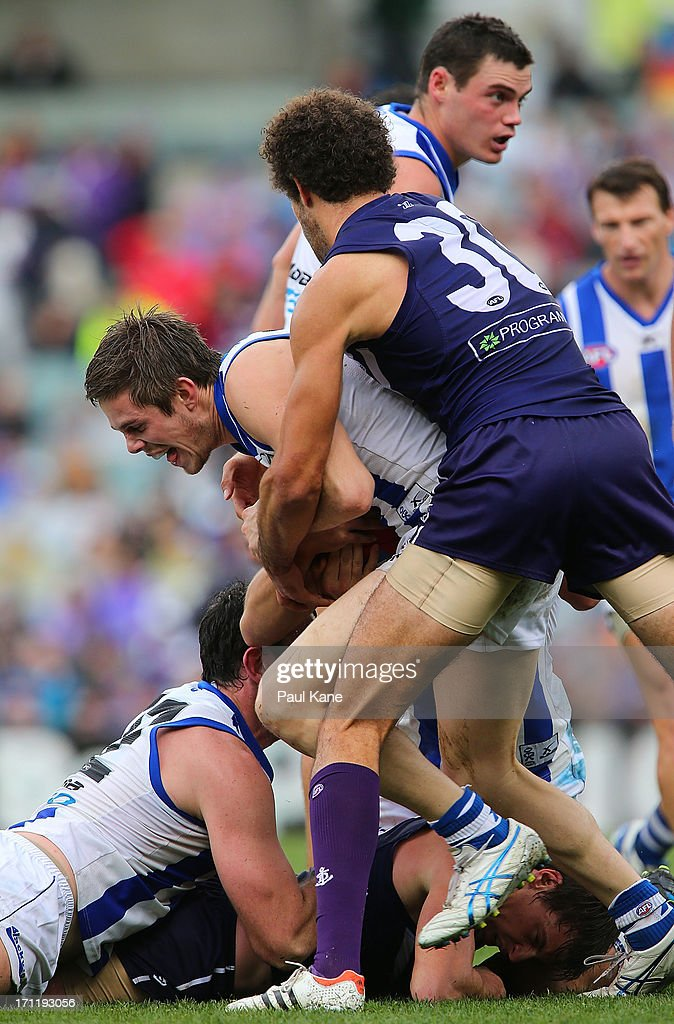 Zac Clarke of the Dockers tackles Ryan Bastinac of the Kangaroos during the round 13 AFL match between the Fremantle Dockers and the North Melbourne Kangaroos at Patersons Stadium on June 23, 2013 in Perth, Australia.