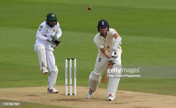 Zac Crawley of England bats watched by Mohammad Rizwan of Pakistan during the second day of the third Test match between England and Pakistan at the...