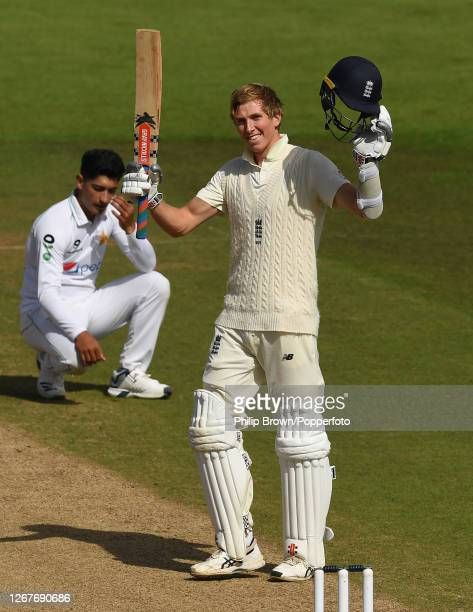 Zac Crawley of England celebrates reaching his double century as Naseem Shah of Pakistan reacts during the second day of the third Test match between...