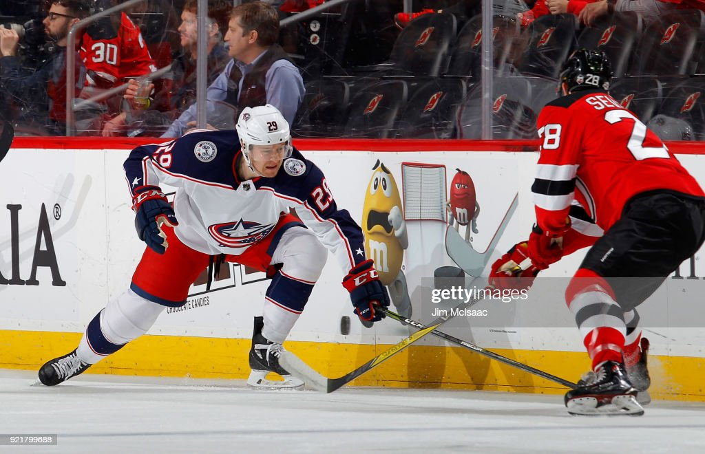 Zac Dalpe #29 of the Columbus Blue Jackets battles for the puck during the first period against Damon Severson #28 of the New Jersey Devils on February 20, 2018 at Prudential Center in Newark, New Jersey.