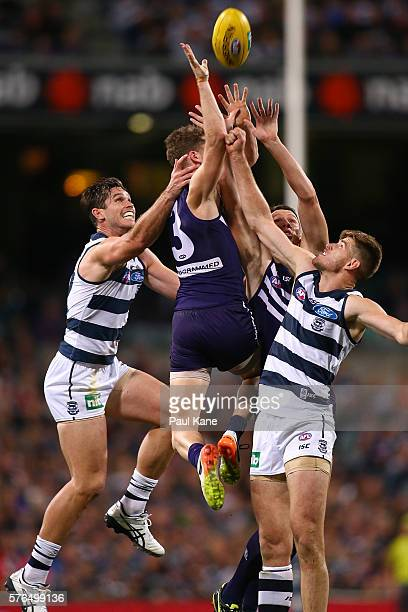 Zac Dawson of the Dockers contests for a mark against Tom Hawkins and Zac Smith of the Cats during the round 17 AFL match between the Fremantle...