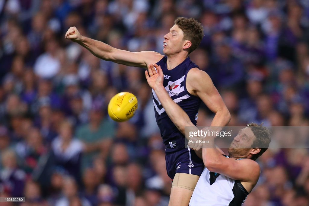 Zac Dawson of the Dockers spoils the mark for Jay Schulz of the Power during the AFL 1st Semi Final match between the Fremantle Dockers and the Port Adelaide Power at Patersons Stadium on September 13, 2014 in Perth, Australia.