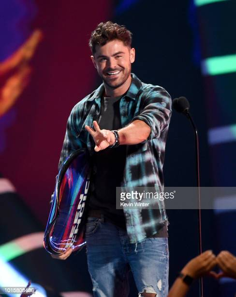 Zac Efron accepts an award onstage during FOX's Teen Choice Awards at The Forum on August 12, 2018 in Inglewood, California.