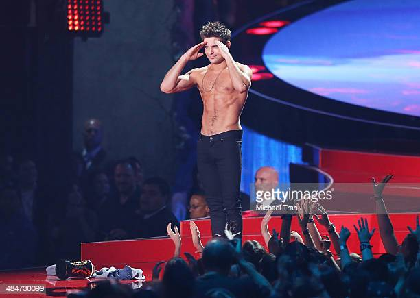 Zac Efron accepts the Best Shirtless Performance award for 'That Awkward Moment' onstage during the 2014 MTV Movie Awards held at Nokia Theatre LA...