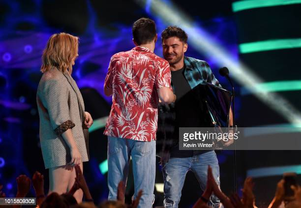 Zac Efron accepts the Choice Drama Movie Actor award for 'The Greatest Showman' from Chloë Grace Moretz and Grant Gustin onstage during FOX's Teen...
