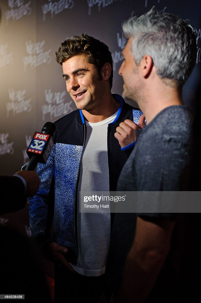 Zac Efron and Director/Screenwriter Max Joseph attends the Chicago premiere of 'We Are Your Friends' at Showplace Icon Theater on August 19, 2015 in Chicago, Illinois.