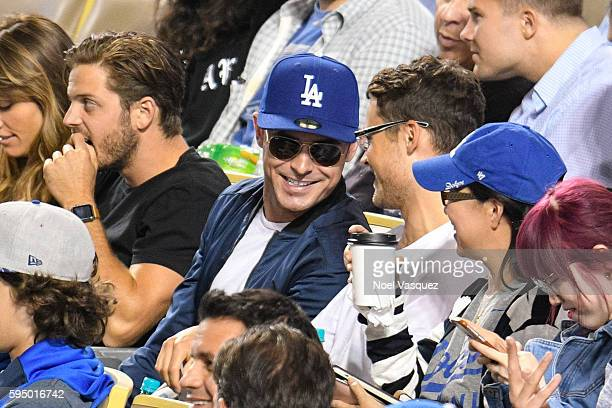 Zac Efron and Dylan Efron attend a baseball game between the San Francisco Giants and the Los Angeles Dodgers at Dodger Stadium on August 24 2016 in...