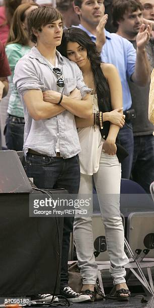 Zac Efron and Vanessa Hudgens cast members of the High School Musicals movies watch the last few minutes of Game Four of the Western Conference...