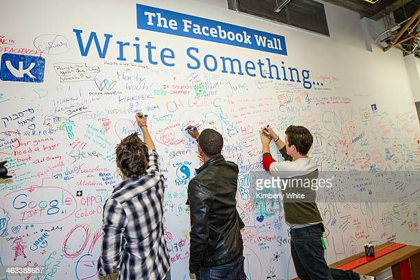 Zac Efron Michael B Jordan and Miles Teller sign a wall at Facebook headquarters on January 14 2014 in San Francisco California