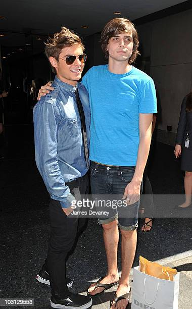 Zac Efron poses with a fan outside NBC Studios in Rockefeller Center on July 27 2010 in New York City
