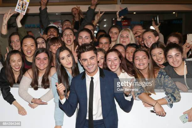 Zac Efron poses with fans ahead of the Australian Premiere of Baywatch on May 18 2017 in Sydney Australia