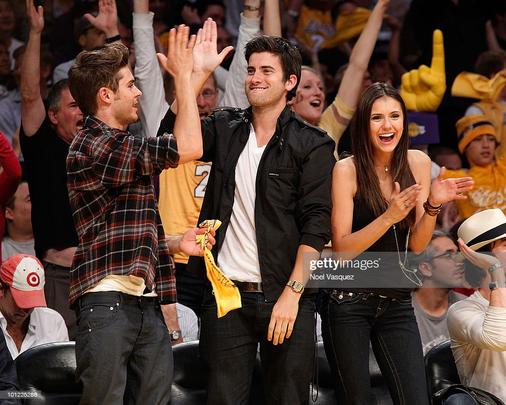 Zac Efron, Ryan Rottman and Nina Dobrev attend Game Five of the Western Conference Finals between the Phoenix Suns and the Los Angeles Lakers during the 2010 NBA Playoffs at Staples Center on May 27, 2010 in Los Angeles, California.