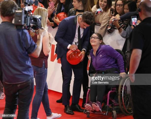 Zac Efron signs a fans Baywatch beachball the Australian Premiere of Baywatch on May 18 2017 in Sydney Australia