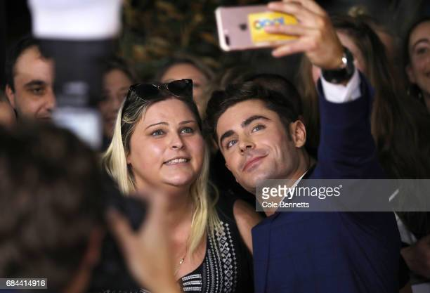 Zac Efron takes selfies with fans ahead of the Australian Premiere of Baywatch on May 18 2017 in Sydney Australia