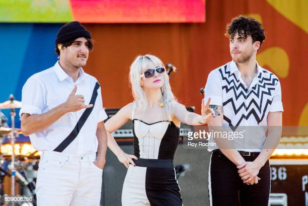 """Zac Farro, Hayley Williams and Taylor York of Paramore perform on ABC's """"Good Morning America"""" at Rumsey Playfield on August 25, 2017 in New York..."""