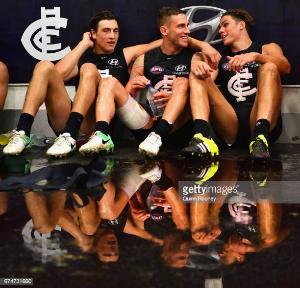 Zac Fisher, Billie Smedts and Charlie Curnow of the Blues celebrate in the rooms after winning the round six AFL match between the Carlton Blues and...