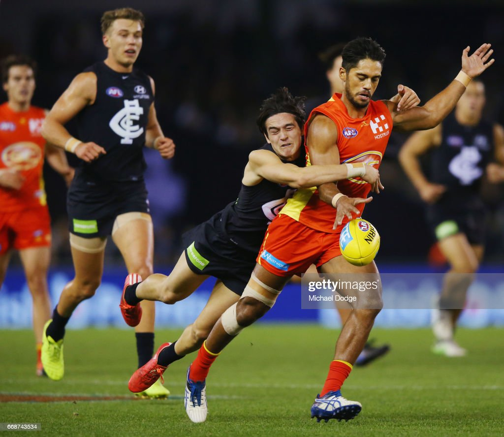 Zac Fisher of the Blues tackles Aaron Hall of the Suns during the round four AFL match between the Carlton Blues and the Gold Coast Suns at Etihad Stadium on April 15, 2017 in Melbourne, Australia.