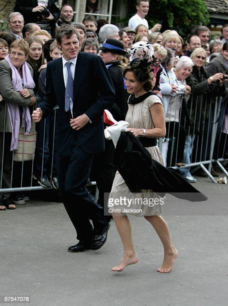 Zac Goldsmith and his wife Sheherazade Goldsmith run as they try to arrive on time at St Cyriac's Church Lacock for the weddinf of Harry Lopes and...